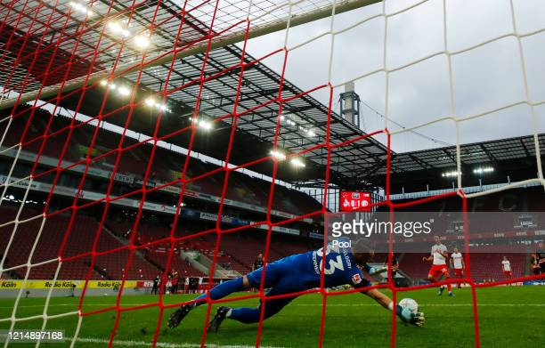 Fortuna Dusseldorf's Florian Kastenmeier saves a penalty shot during the Bundesliga match between 1. FC Koeln and Fortuna Duesseldorf at...