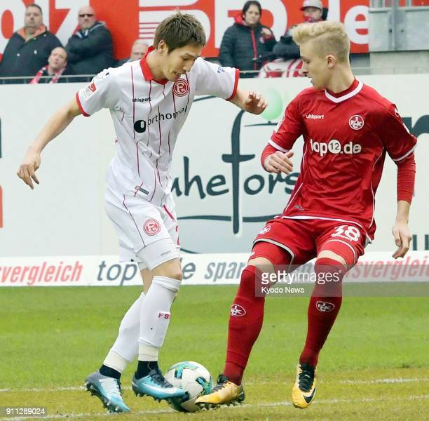 Fortuna Dusseldorf's Genki Haraguchi and Nils Seufert of Kaiserslautern vie for the ball in the first half of a German seconddivision match in...