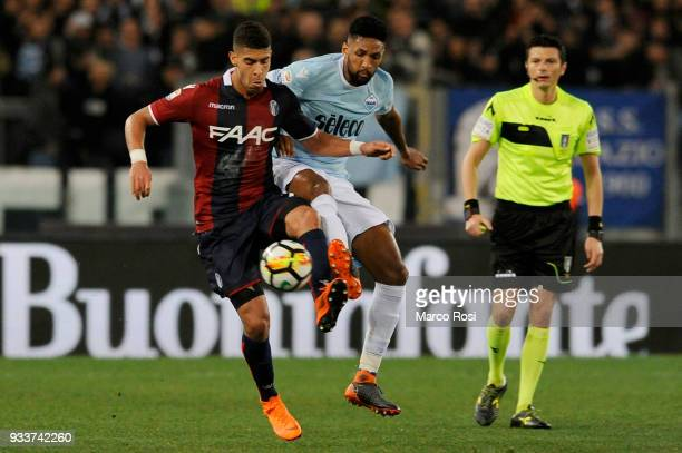 Fortuna Wallace of SS Lazio compete for the ball with Adam Masina of Bologna FC during the serie A match between SS Lazio and Bologna FC at Stadio...