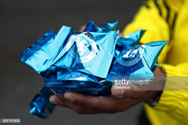 Fortune cookies are handed out to fans outside the stadium to celebrate Chinese New Year before the Premier League match between Chelsea and Arsenal...