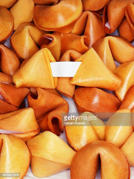 Fortune Cookies with One Broken Displaying Blank Paper