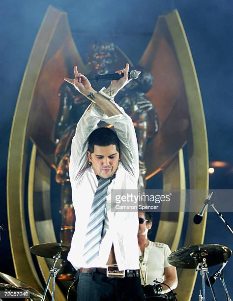 Fortune of INXS performs in front of a giant replica of the NRL Premiership trophy before the NRL Grand Final match between the Brisbane Broncos and...
