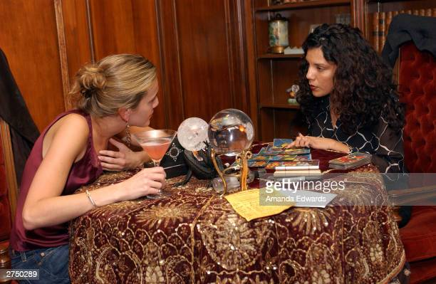 Fortune teller Deseret gives a tarot card reading at A Night of Celebration in honor of director Rob Minkoff and the completion of The Haunted...