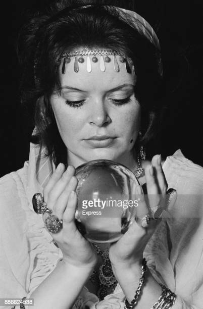 A fortune teller holding a crystal ball UK 2nd July 1971
