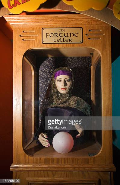 A fortune teller in a wooden box