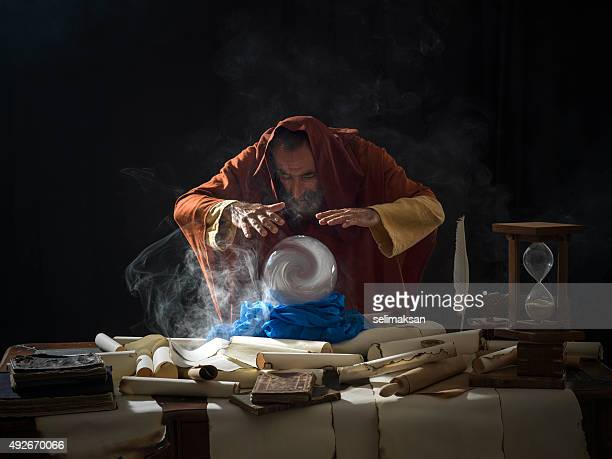 fortune teller in fantastical costume using crystal ball - crystal stock pictures, royalty-free photos & images