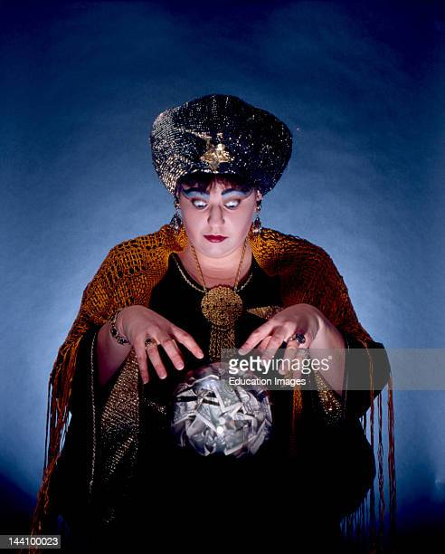 Fortune Teller Looking Into Crystal Ball Filled With Money