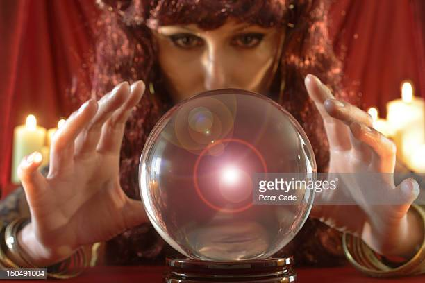 Fortune teller looking into crystal ball