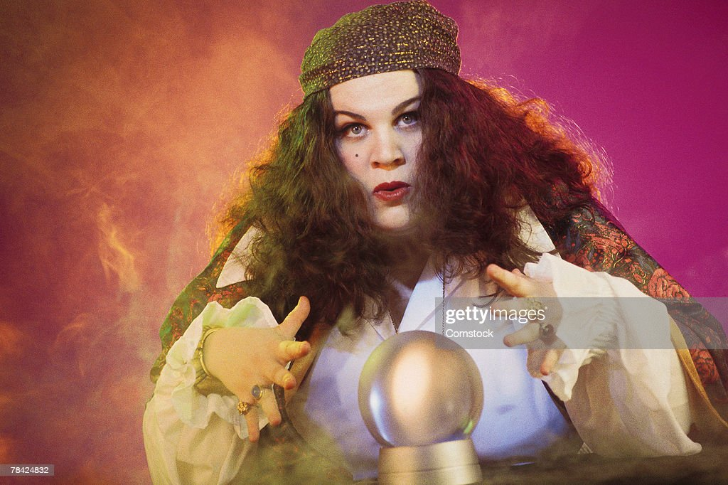 Fortune teller with crystal ball : Stock Photo