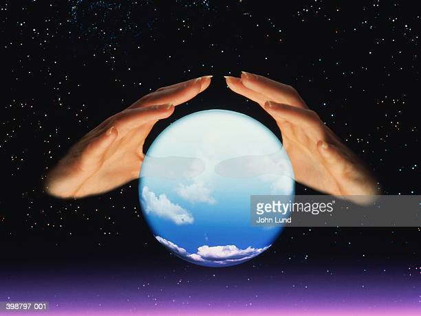 fortune tellers hands and crystal ball - fortune telling stock pictures, royalty-free photos & images