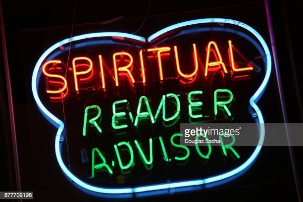 fortune teller's shop illuminated neon advertising sign - fate stock photos and pictures