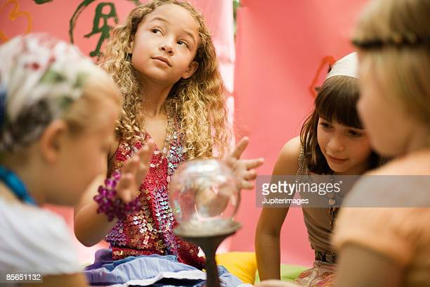 Fortune telling girls with crystal ball