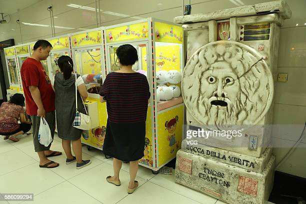 A fortunetell machine is set at an underground mall in People's Square on August 4 2016 in Shanghai China Only three coins one can receive a letter...