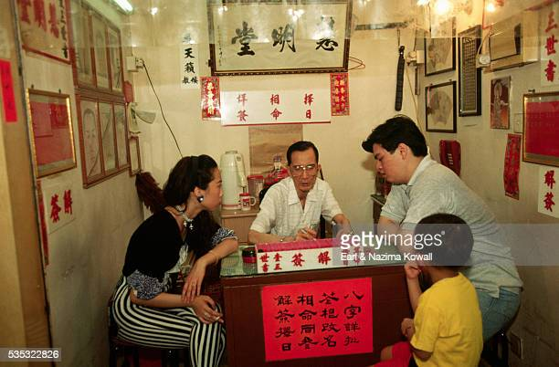 Fortuneteller and Family in Hong Kong Temple