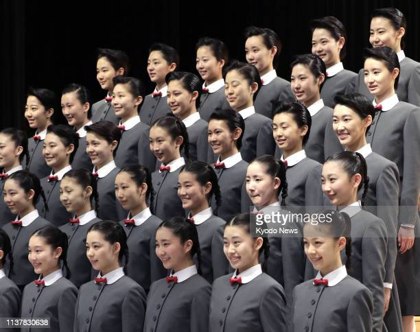 Forty newly enrolled students of the allfemale Takarazuka Music School pose for a photo during an entrance ceremony held in Takarazuka Hyogo...