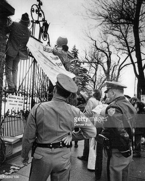 Forty Persons Picketed The Govenors Mansion Tuesday Demonstrators watched by Colorado state patrolmen remove banners they had put on fence around...