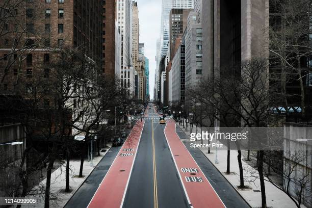 Forty Second Street stands mostly empty as as much of the city is void of cars and pedestrians over fears of spreading the coronavirus on March 22...