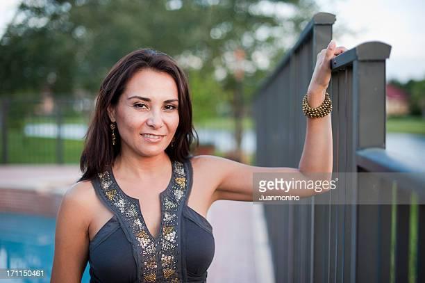 Forty something Hispanic woman posing
