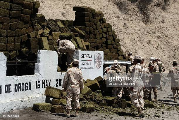 Forty tons of marijuana seized to alleged drug cartels in a house of the bordering city of Tijuana Baja California Mexico are prepared to be burnt by...