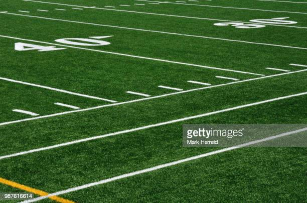 forty yard line on american football field - forty yard line stock pictures, royalty-free photos & images