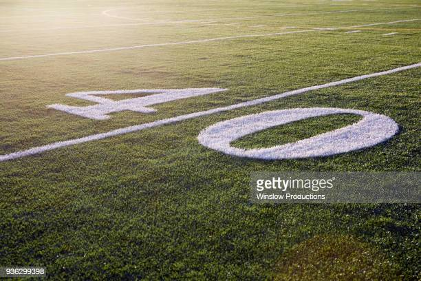 forty yard line on green playing field - forty yard line stock pictures, royalty-free photos & images