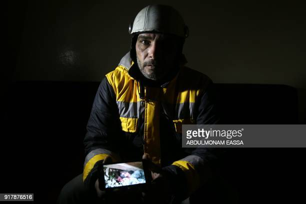 Forty-five-year-old Samir Salim , who along with his three brothers are members of the White Helmets rescue forces, shows a picture that he took when...
