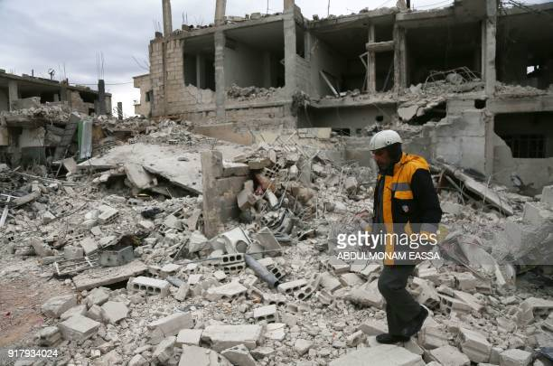 Fortyfiveyearold Samir Salim who along with his three brothers are members of the White Helmets rescue forces walks on the rubble of destroyed...