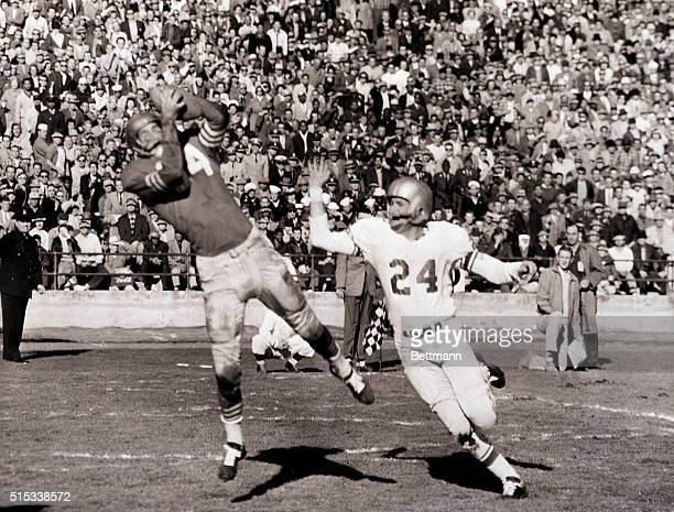 FortyNiner end Billy Wilson snags pass from teammate YA Tittle good for a touchdown in the second quarter of clash with Detroit Lions at Kezar...