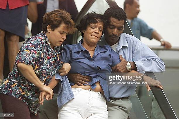 Fortynineyear old Ana Rosa Hierro is escorted out of the Jose Francisco Pena Gomez Airport November 12 2001 in Santo Domingo Dominican Republic after...