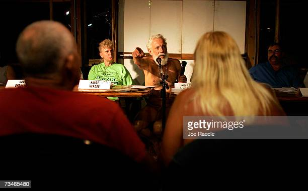Forum moderator Morley Schloss takes a question from the audience during the candidate debate for the open seats on the Loxahatchee Groves Town...