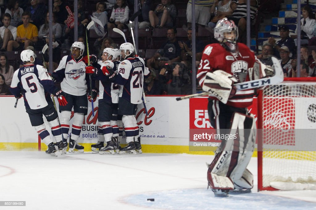 Forward Aaron Luchuk #91 of the Windsor Spitfires celebrates his second period goal against goaltender Anthony Popovich #32 the Guelph Storm on September 24, 2017 at the WFCU Centre in Windsor, Ontario, Canada.