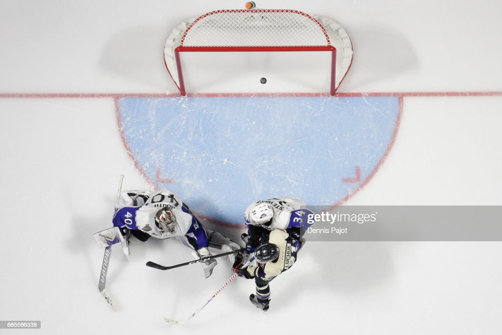 Forward Aaron Luchuk #91 of the Windsor Spitfires deflects the puck for a goal against goaltender Callum Booth of the Saint John Sea Dogs on May 19, 2017 during Game 1 of the Mastercard Memorial Cup at the WFCU Centre in Windsor, Ontario, Canada.