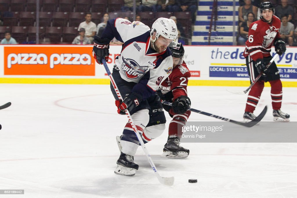 Forward Aaron Luchuk #91 of the Windsor Spitfires moves the puck against the Guelph Storm on September 24, 2017 at the WFCU Centre in Windsor, Ontario, Canada.