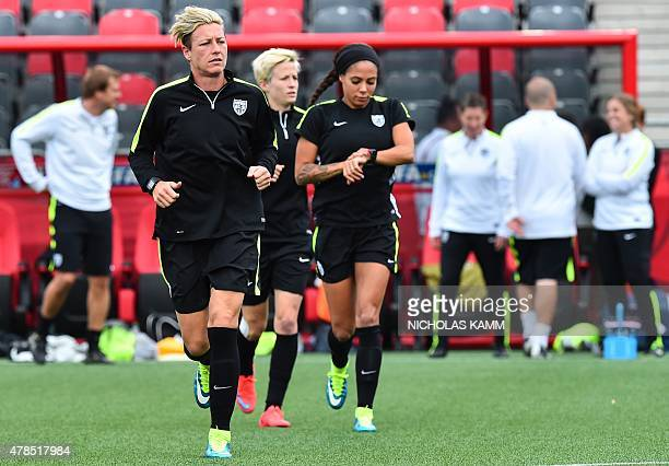USA forward Abby Wambach jogs during a training session at Lansdowne Stadium in Ottawa on June 25 2015 on the eve of their 2015 FIFA Women's World...