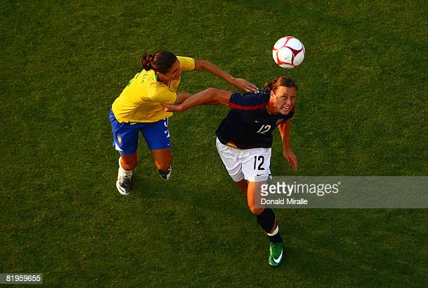 Forward Abby Wambach of the United States clashes for the ball with Andreia Rosa of Brazil during the International Friendly Match between Brazil and...