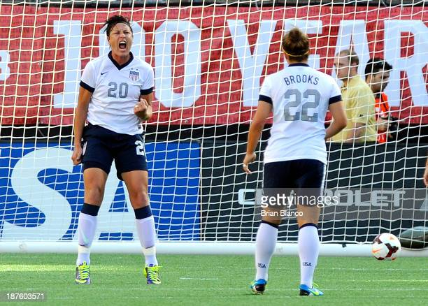 Forward Abby Wambach of the U.S. Women's National Team celebrates with midfielder Amber Brooks after scoring on a penalty kick against Brazil on...