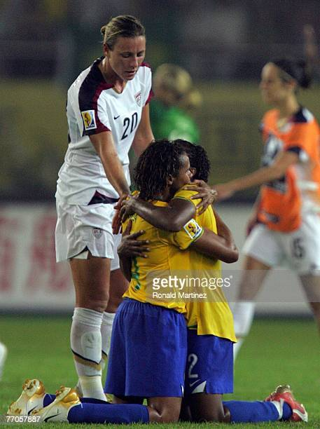 Forward Abby Wambach of USA congratulates Christiane Rozeira De Souza Silva and Elaine Estrela Moura of Brazil on their 40 win during the semifinal...