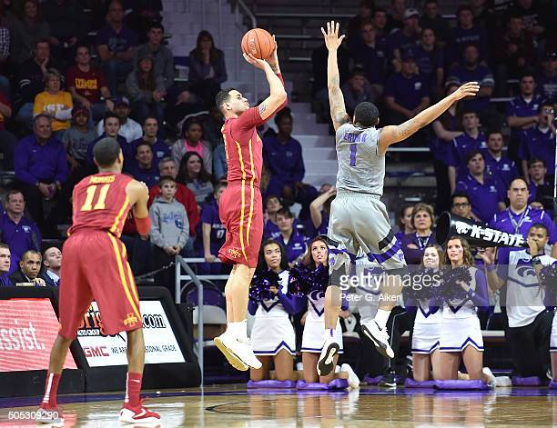 Forward Abdel Nader of the Iowa State Cyclones hits a threepoint shot over guard Carlbe Ervin II of the Kansas State Wildcats during the second half...