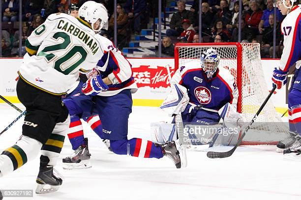 Forward Adrian Carbonara of the London Knights fires the puck against goaltender Michael DiPietro of the Windsor Spitfires on January 3 2017 at the...