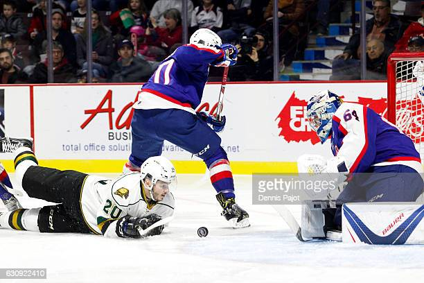 Forward Adrian Carbonara of the London Knights moves for the puck in front of the net against goaltender Michael DiPietro of the Windsor Spitfires on...