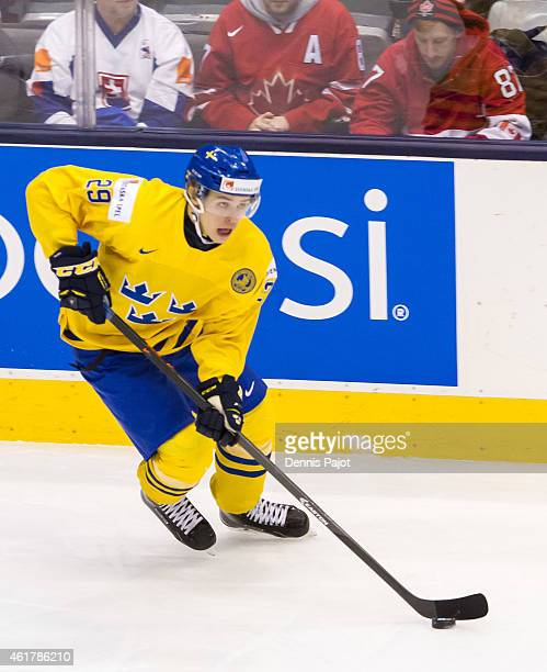 Forward Adrian Kempe of Sweden moves the puck against Slovakia during the Bronze medal game of the 2015 IIHF World Junior Championship on January 05...