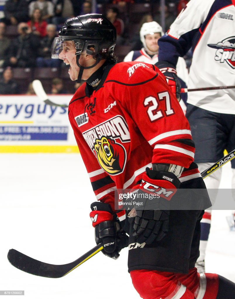 Forward Aidan Dudas #27 of the Owen Sound Attack celebrates his game-tying goal in the third period during a game against the Windsor Spitfires on November 16, 2017 at the WFCU Centre in Windsor, Ontario, Canada.