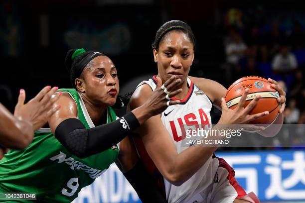 Forward A'ja Wilson vies with Nigeria's forward Aisha Mohammed during the FIBA 2018 Women's Basketball World Cup quarter final match between United...