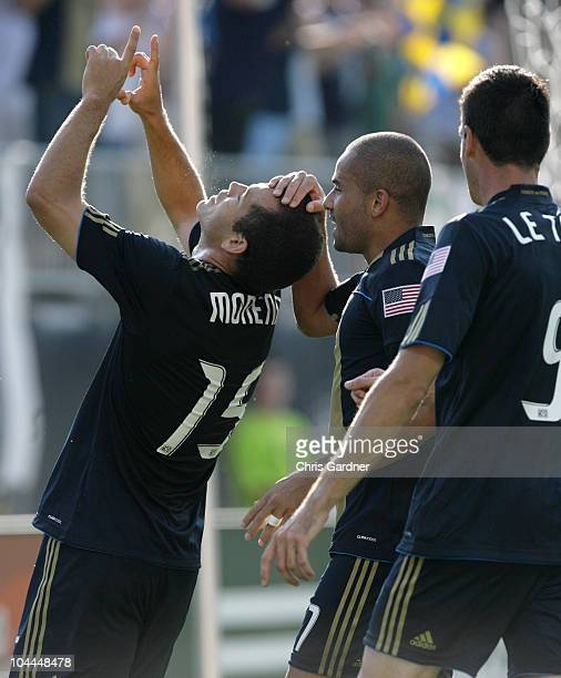 Forward Alejandro Moreno of the Philadelphia Union is congratulated by teammate Fred and Sebastien Le Toux after scoring against Chivas USA in the...