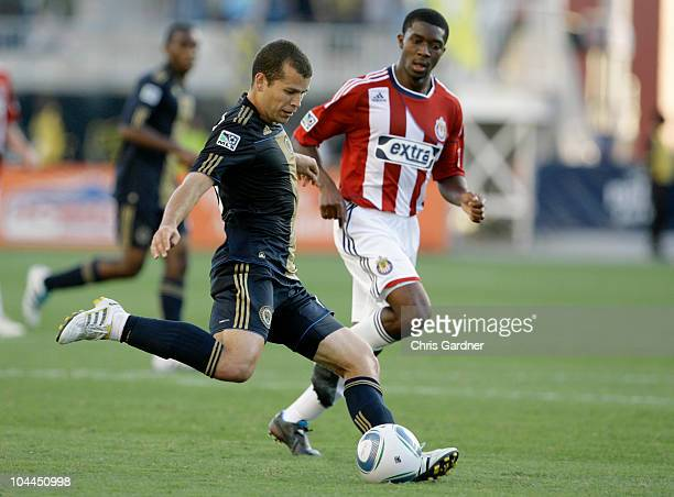 Forward Alejandro Moreno of the Philadelphia Union kicks the ball across the field while being defended by midfielder Michael Lahoud of Chivas USA in...