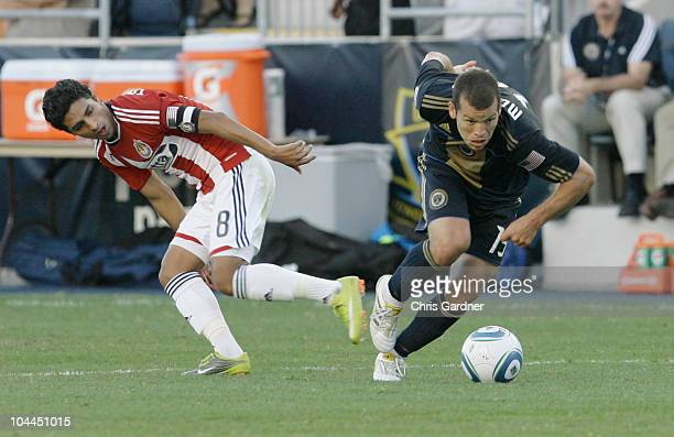 Forward Alejandro Moreno of the Philadelphia Union steals the ball from defenseman Mariano Trujillo of Chivas USA in the second half of their game at...