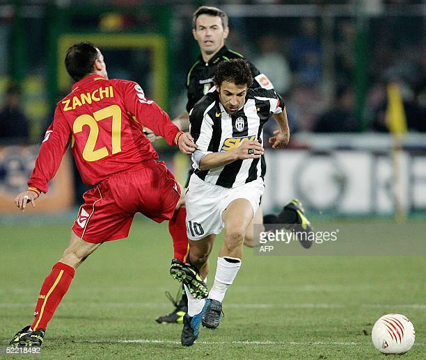 Forward Alessandro Del Piero of Juventus is tackled by Marco Zanchi of FC Messina during their Italian Serie A football match at St Filippo stadium...