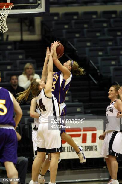 Forward Alex Andrews of Minnesota State University Mankato shoots over forward Marielle Giroud of Franklin Pierce during the Division II Women's...