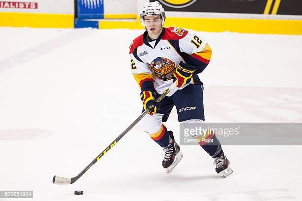 Forward Alex DeBrincat of the Erie Otters moves the puck against the Windsor Spitfires on February 6 2016 at the WFCU Centre in Windsor Ontario Canada