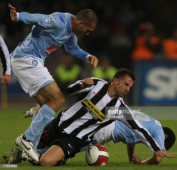 FC forward Alex Del Piero fights for the ball against Napoli's defenders Walter Gargano and Paolo Cannavaro during their Calcio football match...